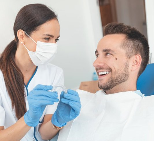 Raleigh dentist and patient discuss Invisalign in Raleigh
