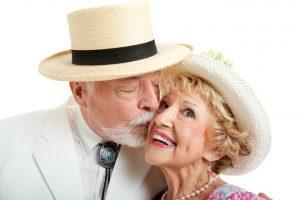 older man kissing older woman