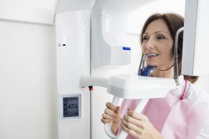 woman receiving digital x-ray scan