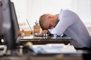 A man asleep at his job.