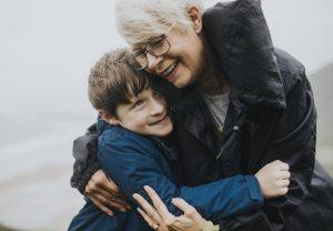 grandparent hugging child