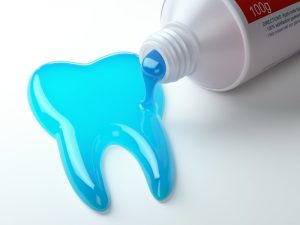 toothpaste spilling out in the shape of a tooth