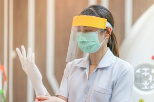 Raleigh dentist wears PPE in preparation for appointment in COVID-19